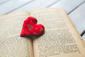 red heart on a old opened book free stock photo