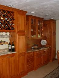 fancy built in wine fridge with grey color kitchen cabinets and