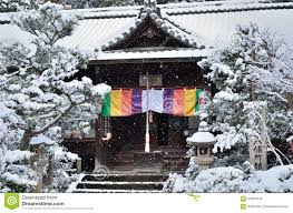 snow falling on japanese garden in kyoto stock photo image