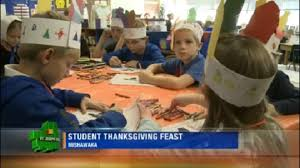 elementary students reenact thanksgiving feast