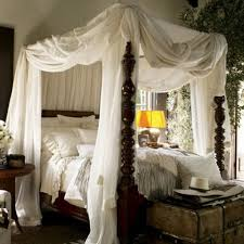 elegant romantic bedroom with canopy bed featured white fabrics