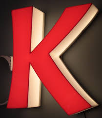 large mid century metal letters glüc and illuminated letter k for