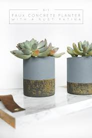 faux concrete planters with a rust patina monthly diy challenge