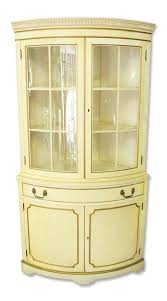 french country corner cabinet with curved glass front olde good
