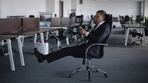 Big Armchair A Young Businessman Is Turning Around Sitting In Armchair In The