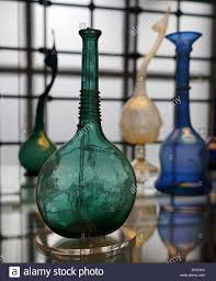 blue glass bottle with applied ornament dated 18th century stock