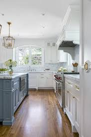 grey kitchen island white kitchen with stacked cabinets and grey island home bunch