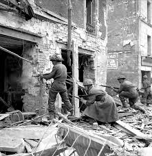siege social caen caen ww2 riders schmiezer into battered house 10