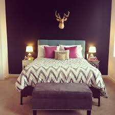 gorgeous bedroom with dark walls love the white bedspread and