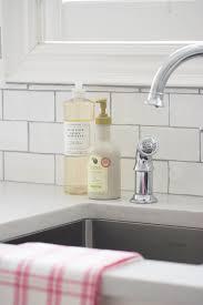 Bathroom White Tile Backsplash With Silestone Lagoon Countertop - Silestone backsplash