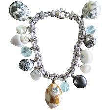 gemstone charm bracelet images Maz amethyst citrine pearl coral onyx sea shell gold charm jpg