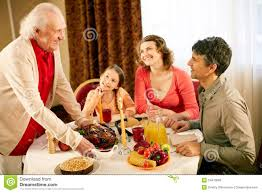 Thanksgiving Dinner Table by Gathered At Dinner Table Royalty Free Stock Image Image 34413666