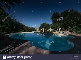 Moonlight Landscape Lighting by Moonlight Lighting Up A Swimming Pool On A Clear Deep Blue Starry