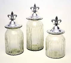 clear glass kitchen canisters set of 3 clear glass kitchen canisters with cast aluminum fleur