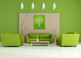 living room with green colour chairs and a painting on walls color