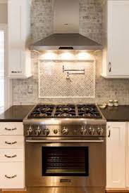 backsplashes for white kitchen cabinets kitchens pot filler tumbled linear tiles backsplash taupe