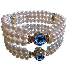pearl bracelet with gold clasp images Triple strand pearl bracelet with blue topaz and diamond 18 karat jpg