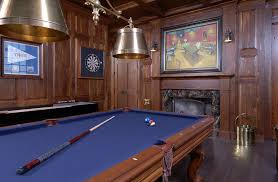 stained wood panels electronic dart boards in family room traditional with stained