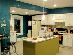 blue wall color plus white wooden kitchen island and stove also