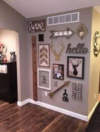 Gallery Wall With Handmade Pallet Clock Httphubzinfothis - Wall decor living room