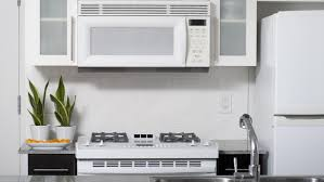 What Is The Standard Height Of Kitchen Cabinets by How Far Does An Over Range Microwave Need To Be From The Top Of
