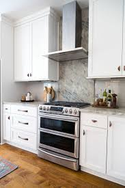what backsplash looks with cherry cabinets considering a backsplash in the kitchen read