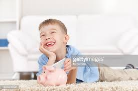 his and piggy bank boy saves money in his piggy bank stock photo getty