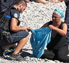 get u0027em off armed police order muslim woman to remove her burkini