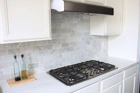 The Kitchen Backsplash Is Done NicelyVia Made By Girl - Marble backsplash tiles