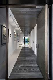 accent lighting for paintings narrow white hallway with wood accent plus decorative track lighting