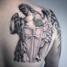 angel tattoo shoulder blade of man title arcangeles