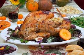 dinner table with roasted thanksgiving turkey is ready to feast