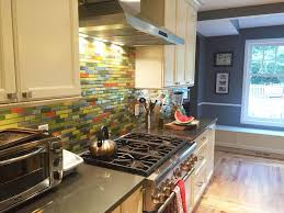steel bamboo remix with orange yellow and grey glass tile kitchen