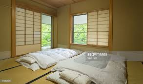 Traditional Japanese Bedroom Furniture - traditional japanese room with futon and tatami stock photo