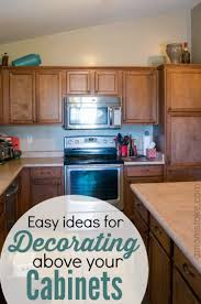 Decorating Ideas For Top Of Kitchen Cabinets by Ideas For Decorating Above Your Cabinets A Mom U0027s Take