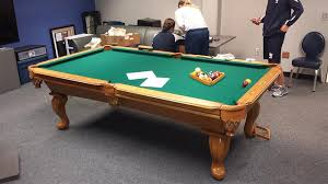 refelting a pool table assembly and refelt on an 8 connelly pool table at the air force