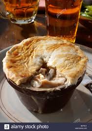 Setting A Table by Individual Chicken Pie With Runner Beans And Beer In A Table
