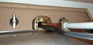 how to install a faucet in the kitchen how to install a kitchen sink faucet today s homeowner