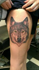 cool wolf with yellow on thigh tattoos book 65 000