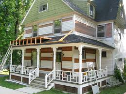 simple front porch decor black rooftop white fence white wooden