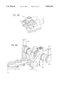 patent us5846282 invert and neck ring holder mechanism for an