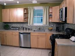 where to put glass cabinets in a kitchen how to decorate the top