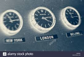 three rolex office wall clocks showing time zones l r new york