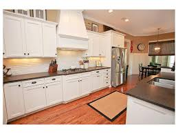 white subway tile leathered granite stainless steel kitchen