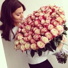 big bouquet of roses girl with big bouquet of roses