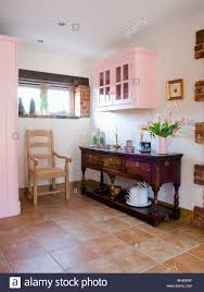 Country Floor by Pale Wood Chair And Antique Sideboard In Country Kitchen With