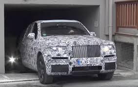 2018 rolls royce cullinan rolls royce cullinan suv spotted leaving mysterious garage in