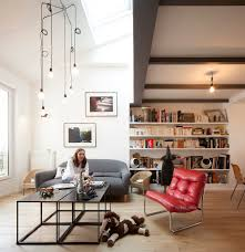 Parisian Living Room by Parisian Apartment Opens Attic To Introduce More Light