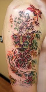 arrows and embers custom tattooing tree half sleeve