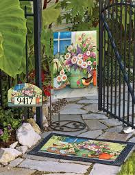 front porch flowers and charming rustic watering cans